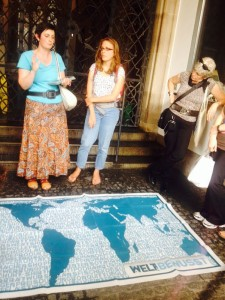 People standing in front of a map discussing aspects of globalisation